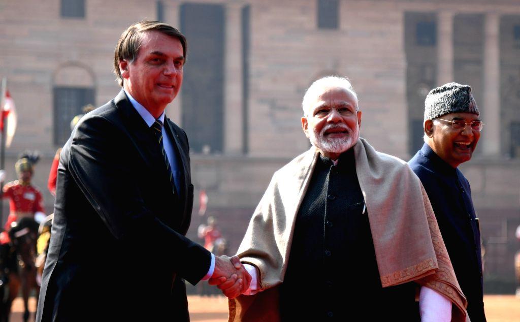 Prime Minister Narendra Modi receives Brazilian President Jair Bolsonaro at a Ceremonial Reception accorded to him at Rashtrapati Bhavan in New Delhi on Jan 25, 2020. Also seen President ... - Narendra Modi and Nath Kovind
