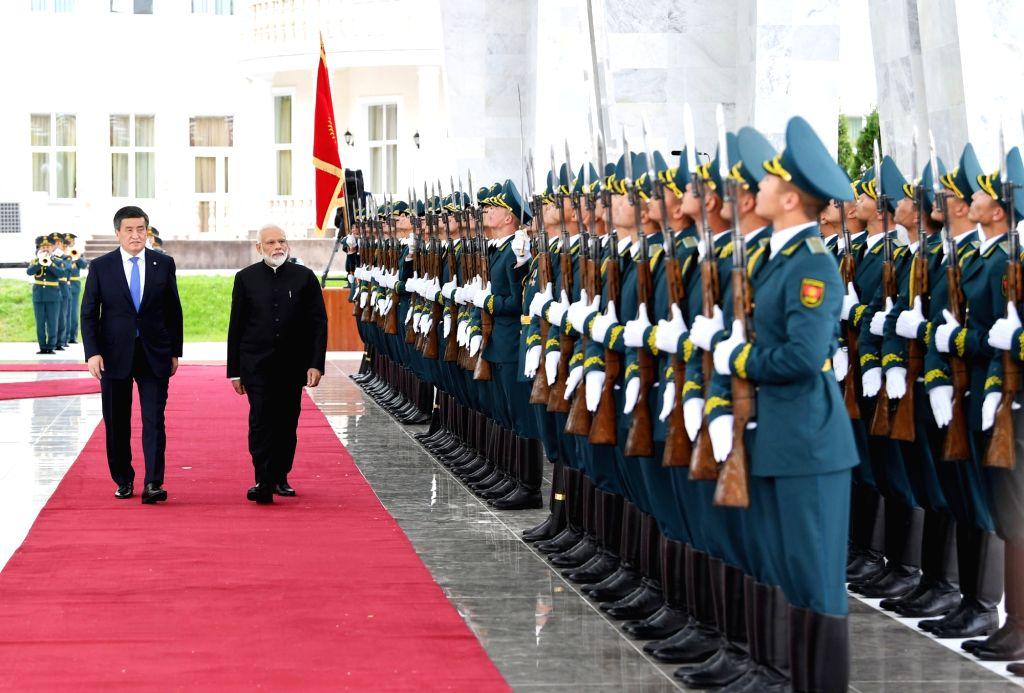 Prime Minister Narendra Modi receives ceremonial welcome in presence of Kyrgyzstan President Sooronbay Jeenbekov , in Bishkek, Kyrgyzstan on June 14, 2019. - Narendra Modi