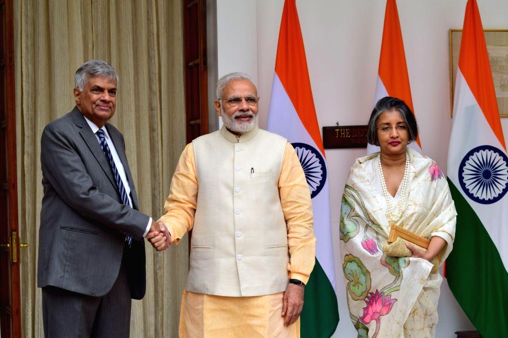 Prime Minister Narendra Modi receives his Sri Lankan counterpart Ranil Wickremesinghe and his wife Maithree Wickremesinghe at Hyderabad House in New Delhi on Oct 5, 2016. - Narendra Modi