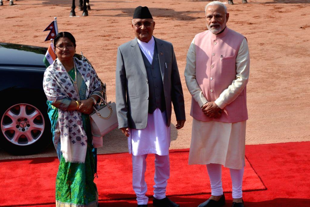 Prime Minister Narendra Modi receives Nepalese Prime Minister K.P. Sharma Oli and his wife Radhika Shakya during the Ceremonial Reception, at Rashtrapati Bhavan in New Delhi on April 7, ... - Narendra Modi and P. Sharma Oli
