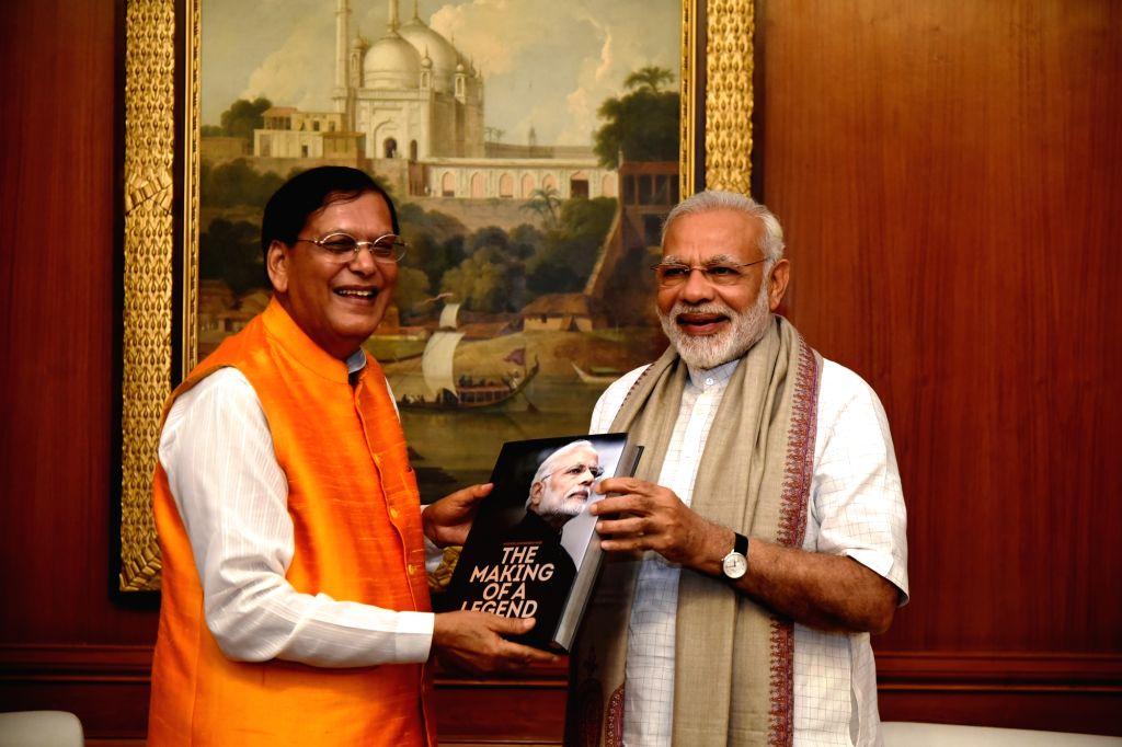 "Prime Minister Narendra Modi receives the book - ""Narendra Modi: The Making of A Legend"" written on him by social service organisation Sulabh International founder Bindeshwar ... - Narendra Modi and Bindeshwar Pathak"