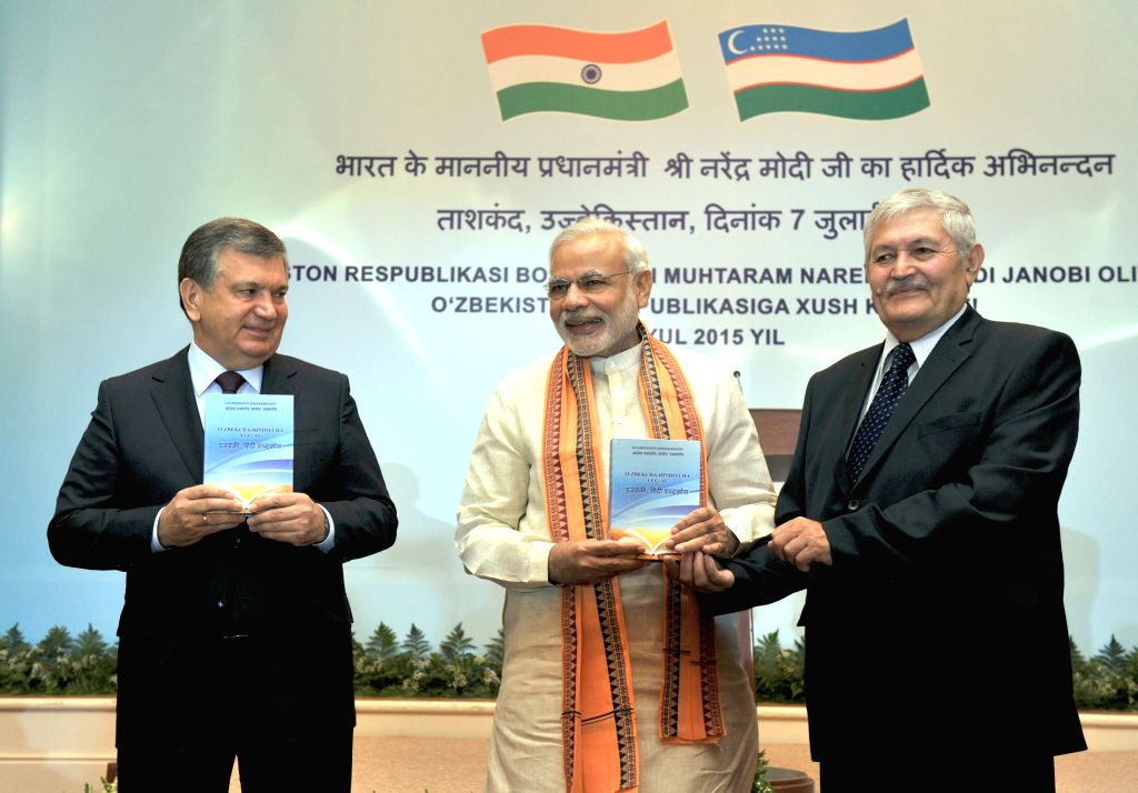 Prime Minister Narendra Modi release the first Uzbek-Hindi dictionary along with the Prime Minister of Uzbekistan Shavkat Miromonovich Mirziyoyev and the Indologist Rakhmatov in Tashkent, ... - Narendra Modi