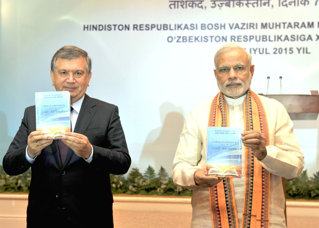 Prime Minister Narendra Modi release the first Uzbek-Hindi dictionary along with the Prime Minister of Uzbekistan Shavkat Miromonovich Mirziyoyev, in Tashkent, Uzbekistan on July 07, 2015. - Narendra Modi