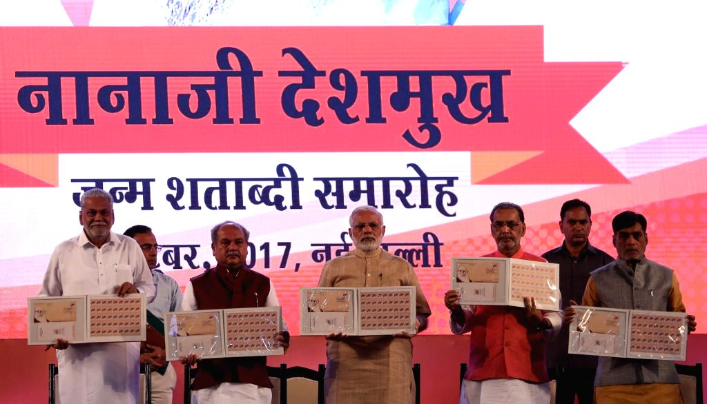 Prime Minister Narendra Modi releases commemorative postage stamp at the birth centenary celebrations of Nanaji Deshmukh at Indian Agricultural Research Institute (IARI) in New Delhi on ... - Narendra Modi, Radha Mohan Singh, Narendra Singh Tomar, Minister and Nanaji Deshmukh
