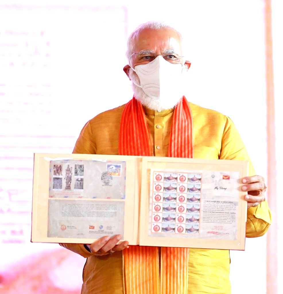 "Prime Minister Narendra Modi releases the Commemorative Postage Stamps during the ""bhumi pujan"" ceremony at the Ram Janmabhoomi site in Ayodhya on Aug 5, 2020. - Narendra Modi"