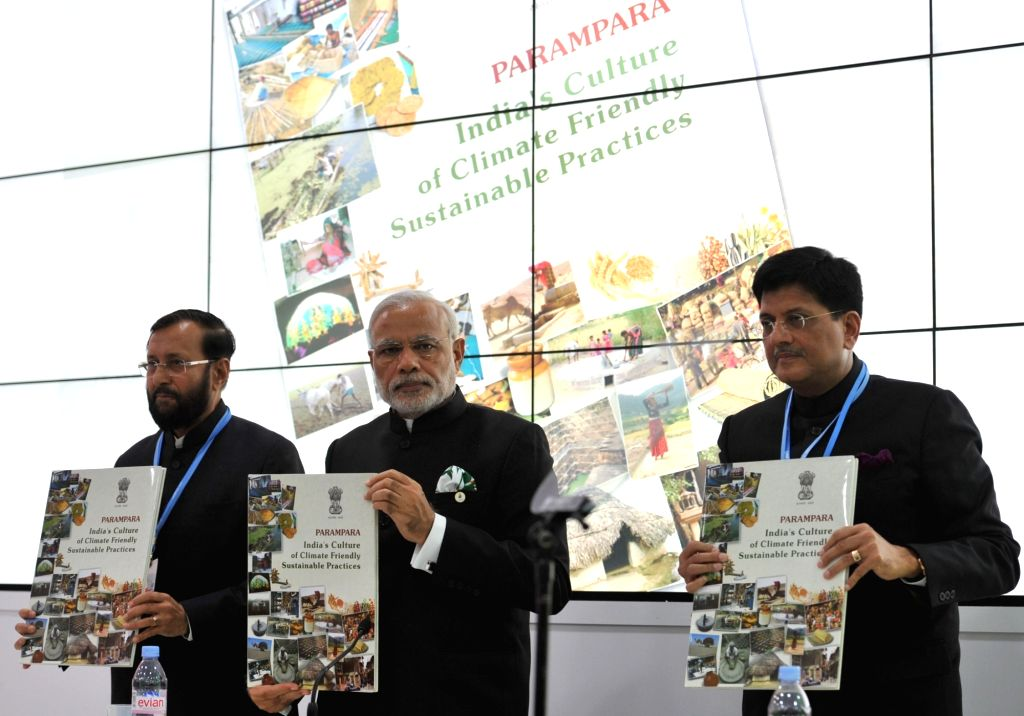 Prime Minister Narendra Modi releasing a book `PARAMPARA` at the inauguration of the India Pavilion, at COP21 Summit, in Paris, France on Nov 30, 2015. Also seen The Minister of State for ... - Narendra Modi
