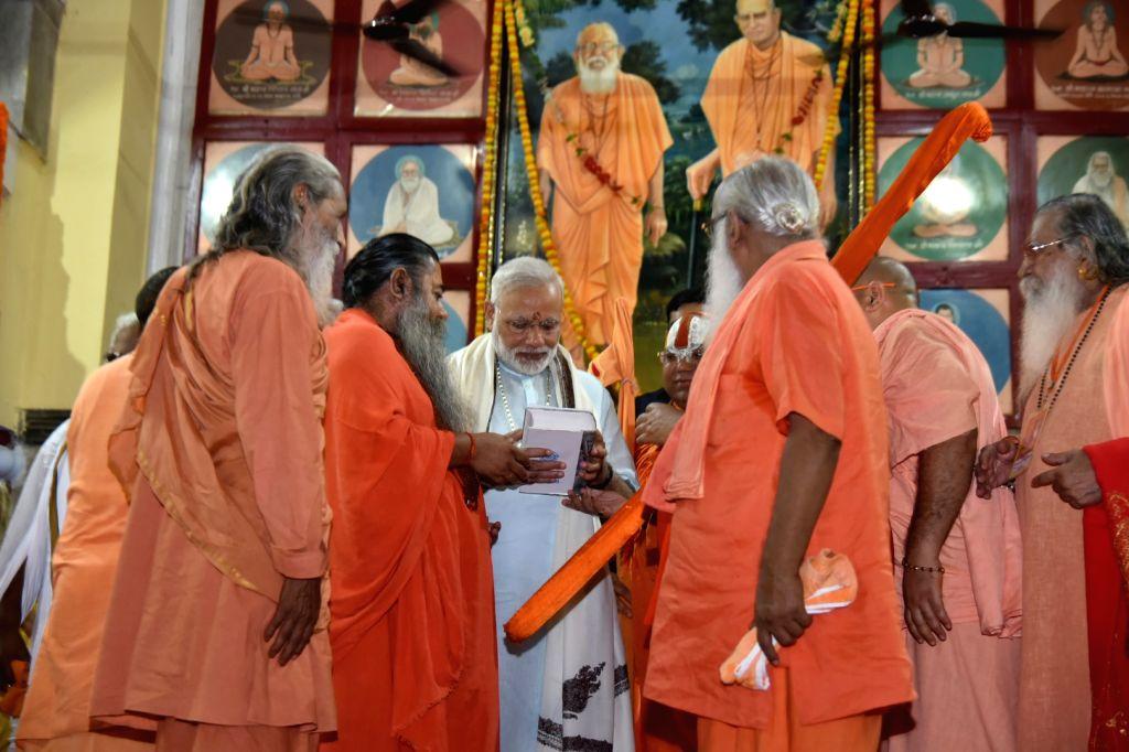 Prime Minister Narendra Modi releasing a memoir on Mahant Avaidyanath ji, at Gorakhnath Mandir, in Gorakhpur, Uttar Pradesh on July 22, 2016. - Narendra Modi