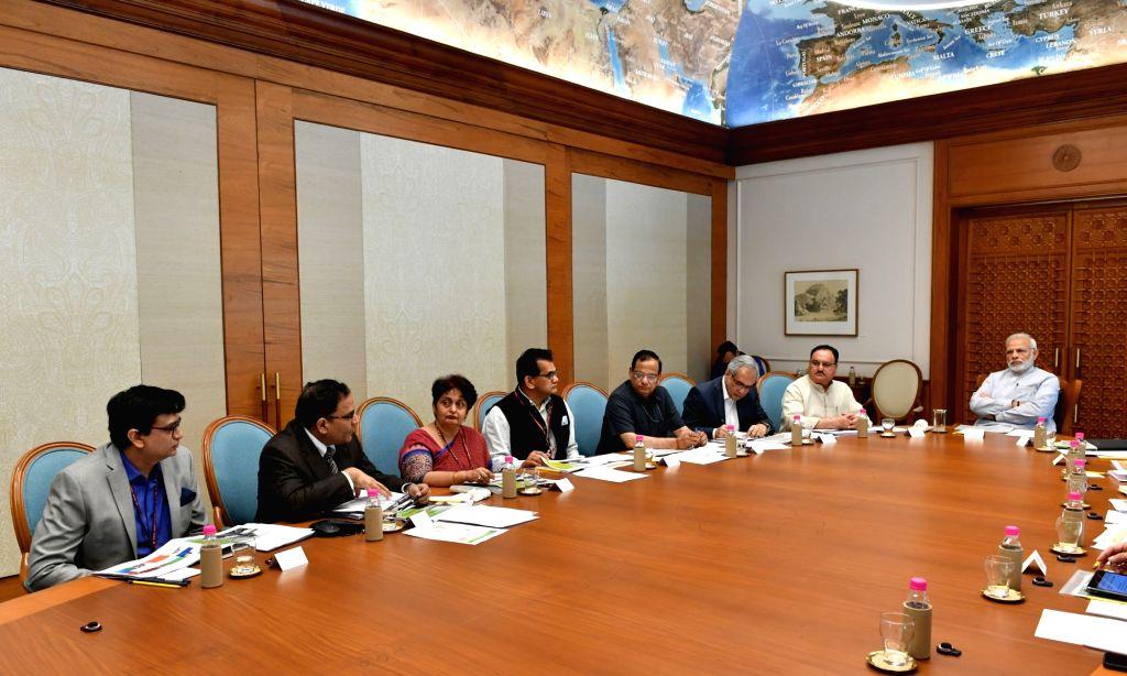Prime Minister Narendra Modi reviews the preparations for launch of Health Assurance programme under Ayushman Bharat in New Delhi on Aug 4, 2018. - Narendra Modi