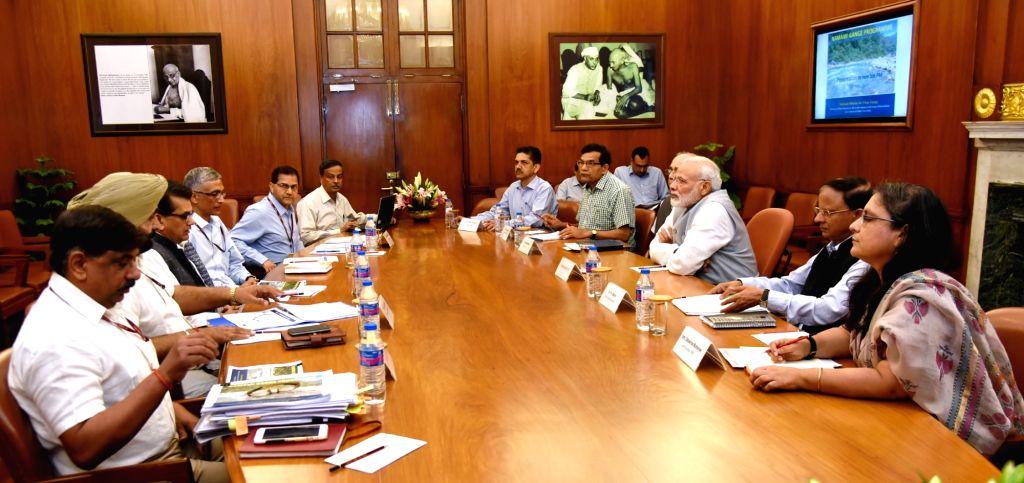 Prime Minister Narendra Modi reviews the progress of the Namaami Gange programme in New Delhi on May 19, 2017. - Narendra Modi