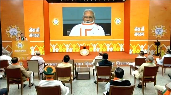 Prime Minister Narendra Modi reviews the relief work done by BJP workers during corona crisis during the 'Seva Hi Sangathan' programme through video conferencing, in New Delhi on July 4, ... - Narendra Modi