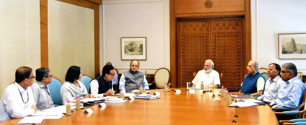 Prime Minister Narendra Modi reviews the status of GST which is to be implemented from July 01, in New Delhi on June 05, 2017. - Narendra Modi