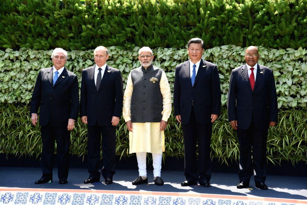 Prime Minister Narendra Modi, Russian President Vladimir Putin, Chinese President Xi Jinping, South African President Jacob Zuma and Brazilian President Michel Temer  during  at the BRICS Summit ... - Narendra Modi