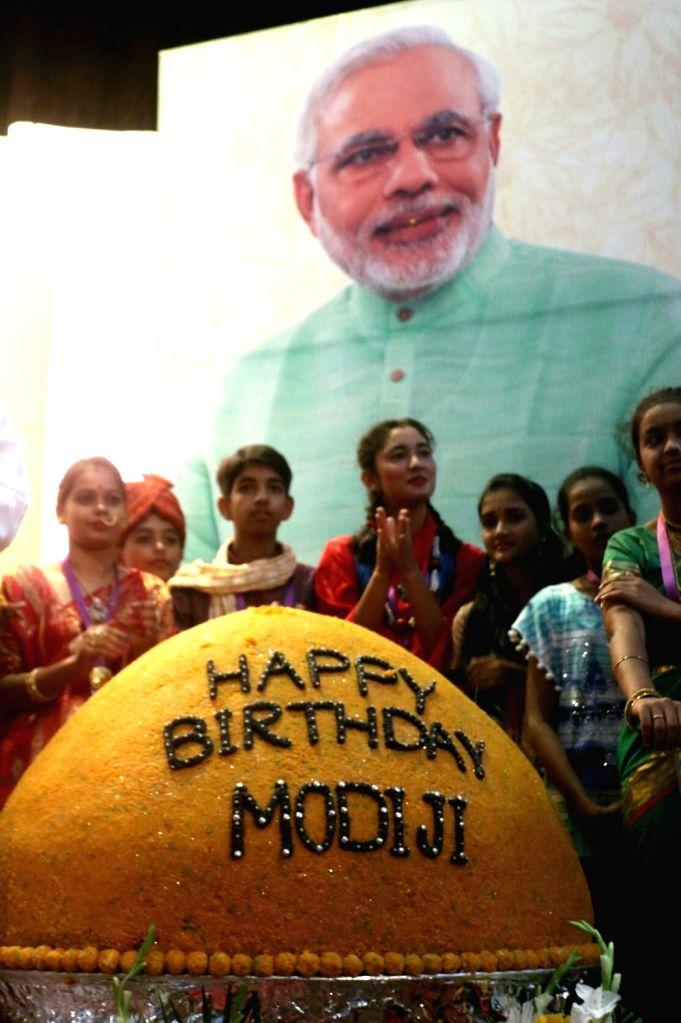 Prime Minister Narendra Modi's birth day being celebrated with a 267 kg jumbo laddu in New Delhi on Sept 17, 2017. - Narendra Modi