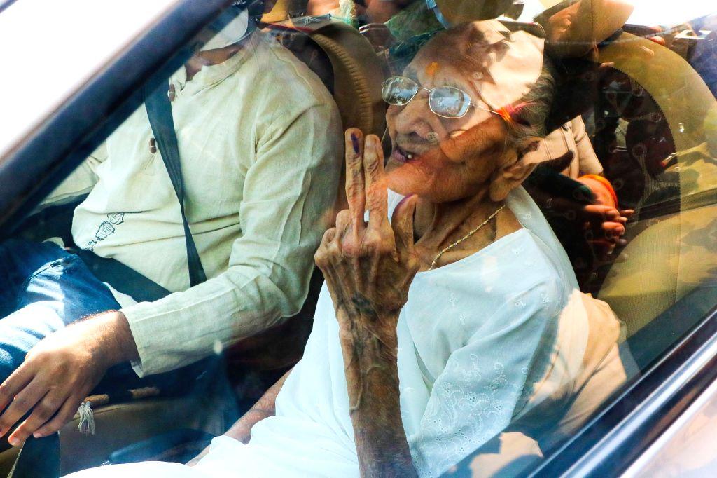 Prime Minister Narendra Modi's mother Heeraben Modi shows he finger marked with indelible ink outside polling centre after cast her vote during Gandhinagar Municipal corporation Elections at ... - Narendra Modi and Heeraben Modi