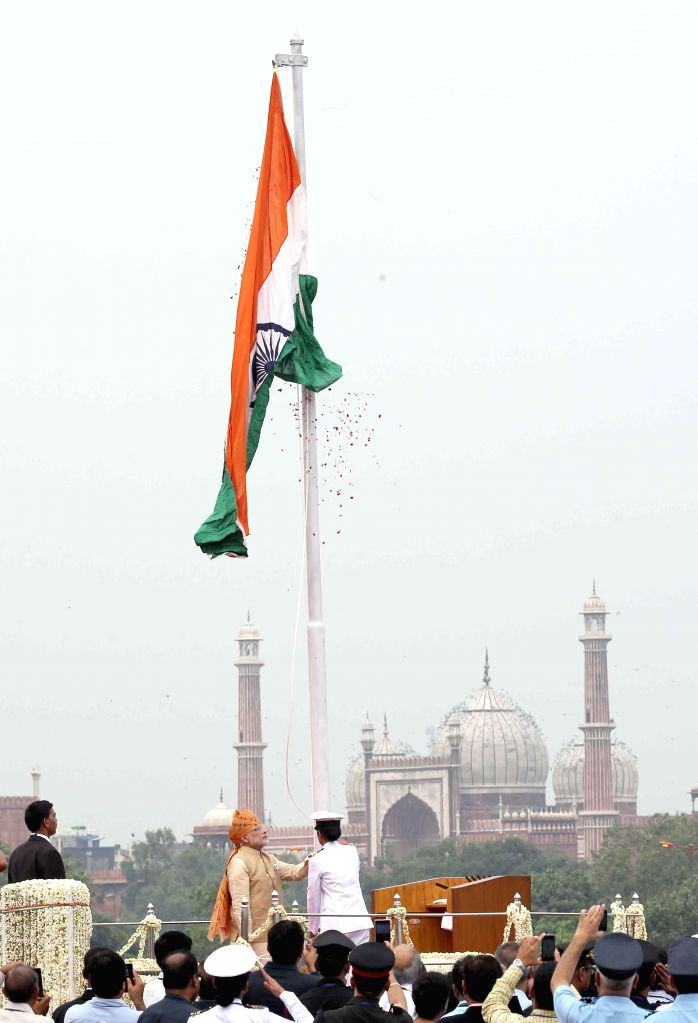 Prime Minister Narendra Modi salutes after unfurling the Tricolour flag at the ramparts of Red Fort, on the occasion of 69th Independence Day, in Delhi on Aug 15, 2015. - Narendra Modi