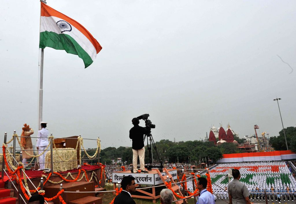 Prime Minister Narendra Modi saluting after unfurling the Tricolour flag at the ramparts of Red Fort, on the occasion of 69th Independence Day, in Delhi on August 15, 2015. - Narendra Modi
