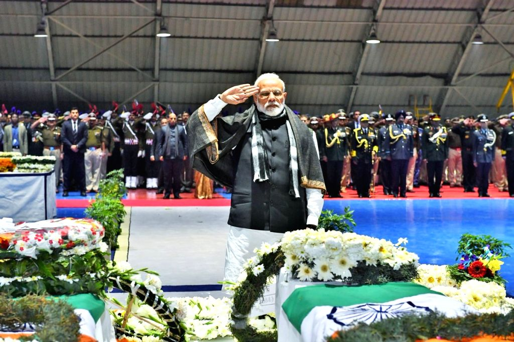 Prime Minister Narendra Modi saluting the CRPF personnel who were killed in a suicide attack by militants in Jammu and Kashmir's Pulwama district on 14th Feb 2019; at Palam Airport in New ... - Narendra Modi
