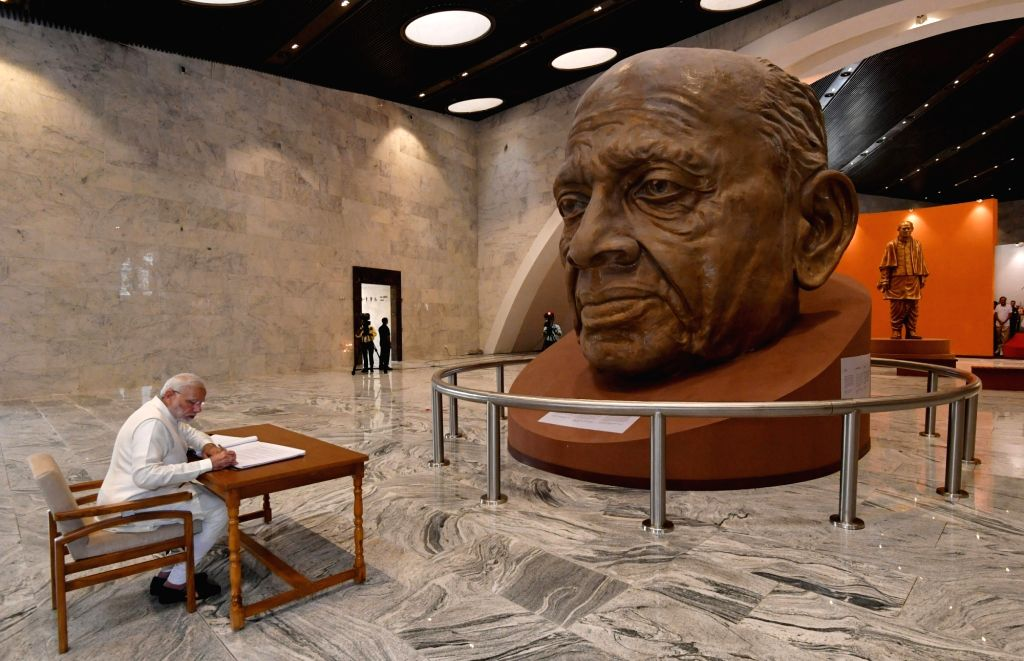 Prime Minister Narendra Modi signs the Visitors' Book of Museum, Exhibition and Viewers' Gallery, during the inauguration of 'Statue of Unity' on the occasion of  'Rashtriya Ekta Diwas' ... - Narendra Modi and Sardar Vallabhbhai Patel