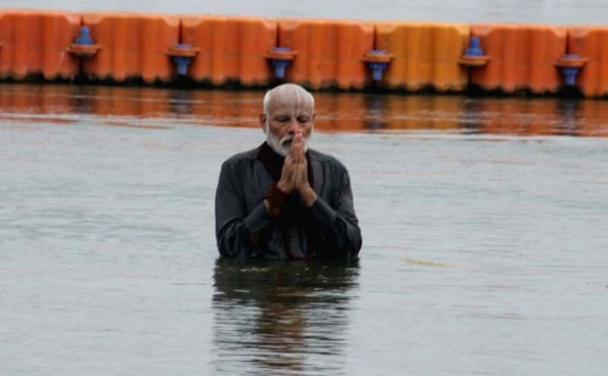 Prime Minister Narendra Modi takes a dip in the Sangamthe holy confluence of the sacred Ganga, Yamuna and the mythical Sarawasti rivers, in Prayagraj on Feb 24, 2019. He also ... - Narendra Modi