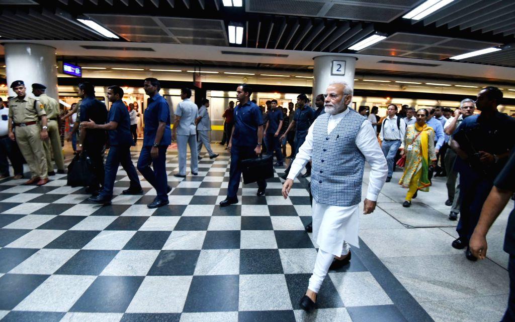 Prime Minister Narendra Modi takes Delhi Metro ride on his way to inaugurate Ambedkar National Memorial at 26 Alipur Road in New Delhi on April 13, 2018. - Narendra Modi