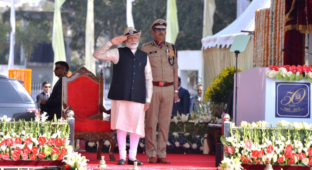 Prime Minister Narendra Modi takes salute during the 50th Raising Day ceremony of Central Industrial Security Forces (CISF) in Ghaziabad, on March 10, 2019. - Narendra Modi