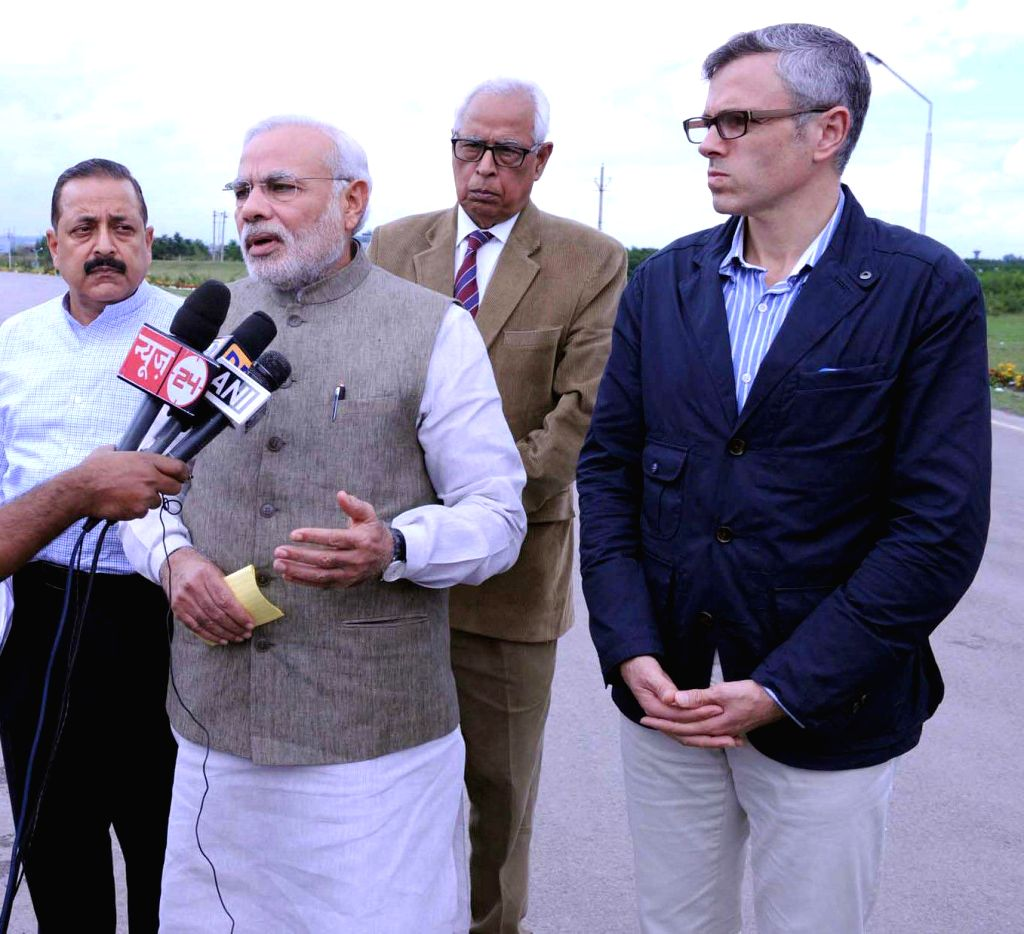 Prime Minister Narendra Modi talks to media after reviewing the flood situation in Jammu and Kashmir on September 07, 2014.  Also seen Jammu and Kashmir Governor N.N. Vohra, Jammu and Kashmir Chief .. - Narendra Modi and Jitendra Singh