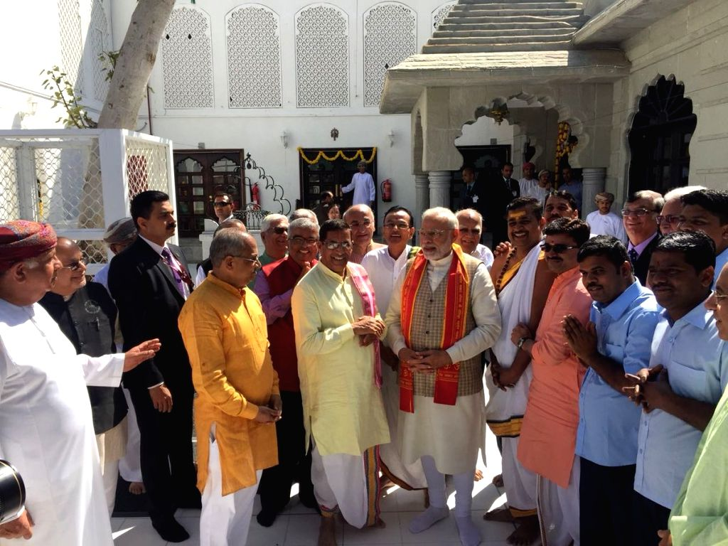 Prime Minister Narendra Modi talks to the Temple Management Committee members during his visit to the Lord Shiva temple in Muscat, Oman on Feb 12, 2018. - Narendra Modi