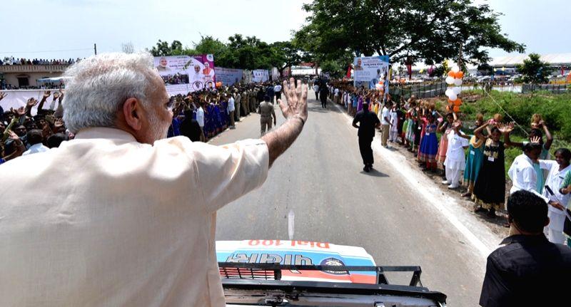 Prime Minister Narendra Modi thanking people who gathered to wish him on his birthday, at Limkheda, in Gujarat on Sept 17, 2016. - Narendra Modi