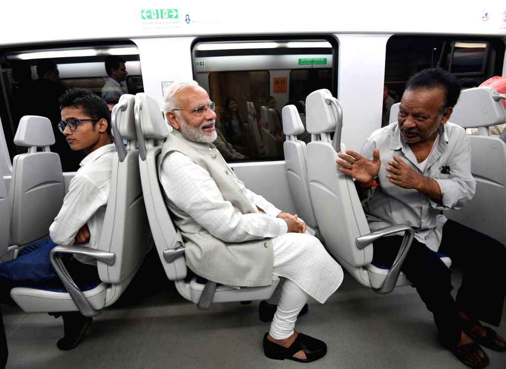Prime Minister Narendra Modi travels in Airport Express Line of the Delhi metro to reach the venue of foundation stone laying ceremony of India International Convention and Expo Centre at ... - Narendra Modi
