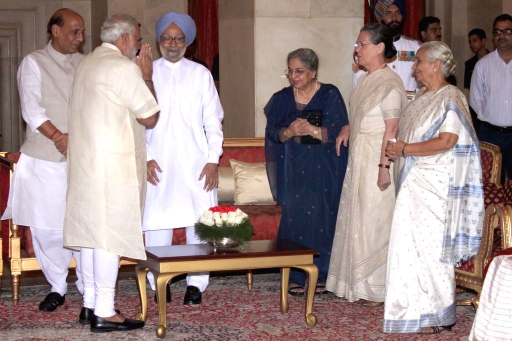 Prime Minister Narendra Modi, Union Home Minister Rajnath Singh, Congress chief Sonia Gandhi and former prime minister and Congress leader Manmohan Singh during a `At Home` programme on ... - Narendra Modi, Rajnath Singh, Sonia Gandhi and Manmohan Singh