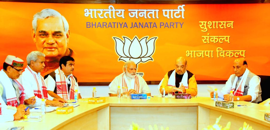 Prime Minister Narendra Modi, Union Home Minister Rajnath Singh and Union Road Transport, Highways and Shipping Minister Nitin Gadkari with BJP chief Amit Shah during BJP Parliamentary ... - Narendra Modi, Rajnath Singh and Amit Shah