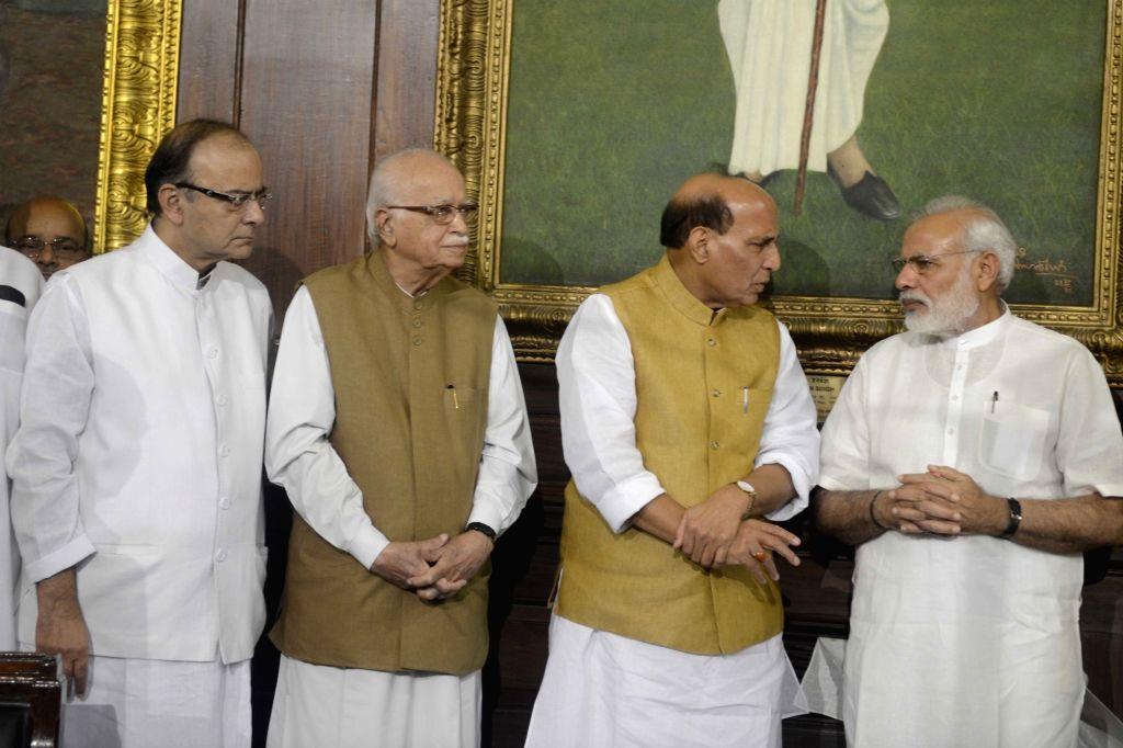 Prime Minister Narendra Modi, Union Home Minister Rajnath Singh, Union Finance and Corporate Affairs Minister Arun Jaitley and BJP veteran L K Advani pay tribute to Dr Syama Prasad ... - Narendra Modi, Rajnath Singh, Arun Jaitley and L K Advani