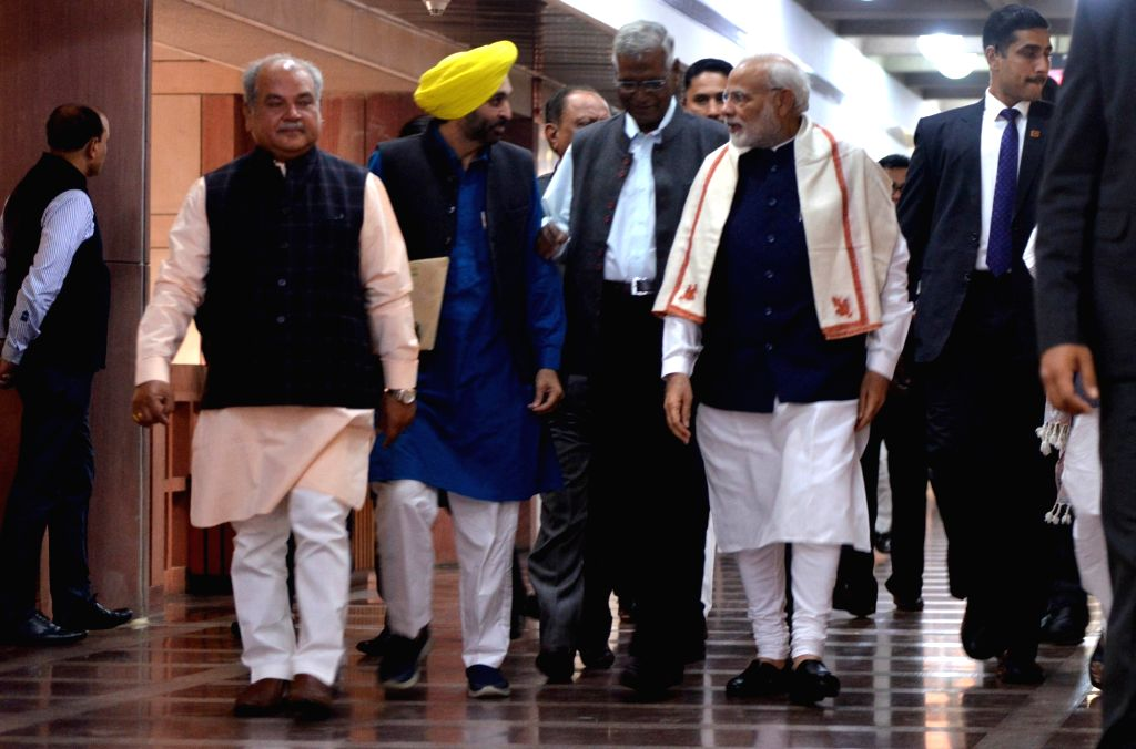 Prime Minister Narendra Modi, Union Minister Narendra Singh Tomar, AAP MP Bhagwant Mann and CPI MP D. Raja arrive to attend an all party meeting ahead of the Winter session of Parliament, ... - Narendra Modi and Narendra Singh Tomar
