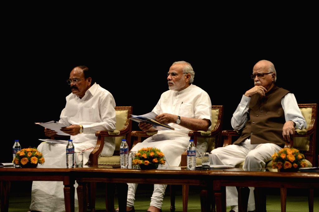 Prime Minister Narendra Modi, Union Minister for Urban Development, Housing and Urban Poverty Alleviation and Parliamentary Affairs M Venkaiah Naidu and BJP veteran LK Advani during BJP ... - Narendra Modi and Venkaiah Naidu