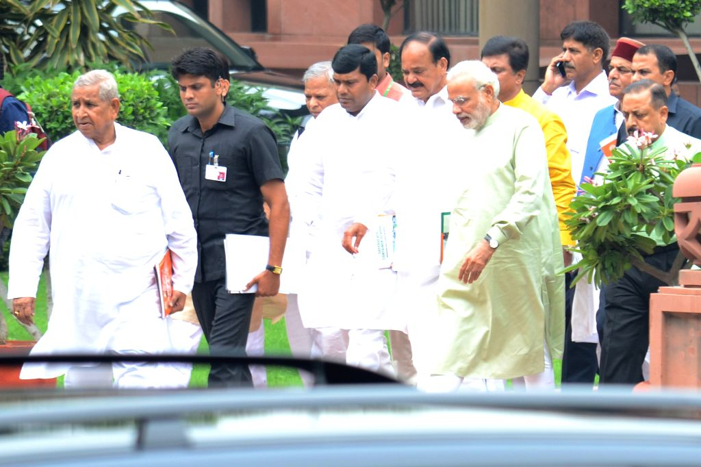 Prime Minister Narendra Modi, Union Minister for Urban Development, Housing and Urban Poverty Alleviation and Parliamentary Affairs M. Venkaiah Naidu and other BJP MPs come out after BJP ... - Narendra Modi and M. Venkaiah Naidu
