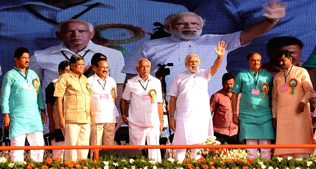 Prime Minister Narendra Modi, Union Ministers DV Sadananda Gowda and Ananth Kumar with B S Yeddyurappa and other BJP leaders during a public rally in Davangere of Karnataka on May 29, 2016. - Narendra Modi and Ananth Kumar