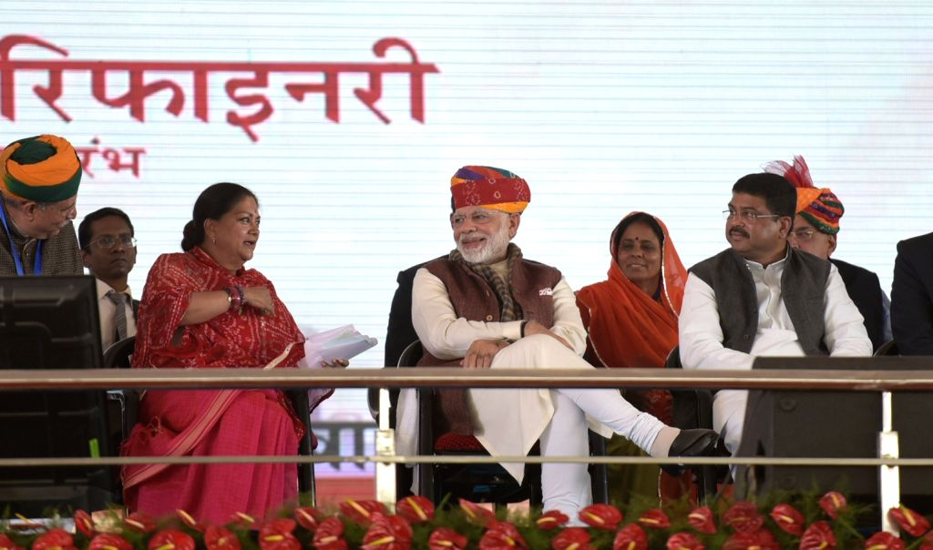 Prime Minister Narendra Modi, Union Petroleum Minister Dharmendra Pradhan and Rajasthan Chief Minister Vasundhara Raje during the commencement of Barmer Refinery in Barmer, Rajasthan on Jan ... - Narendra Modi