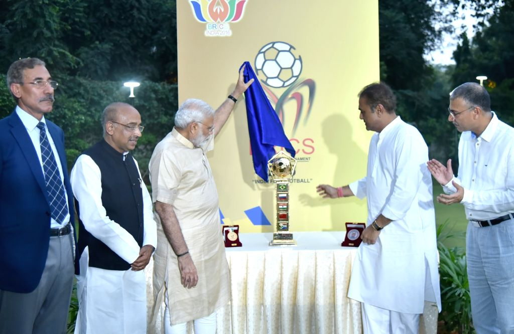 Prime Minister Narendra Modi unveils BRICS U-17 Football Tournament-2016 Trophy in New Delhi on Oct 1, 2016. Also seen Minister of State for Youth Affairs and Sports (I/C), Water ... - Narendra Modi