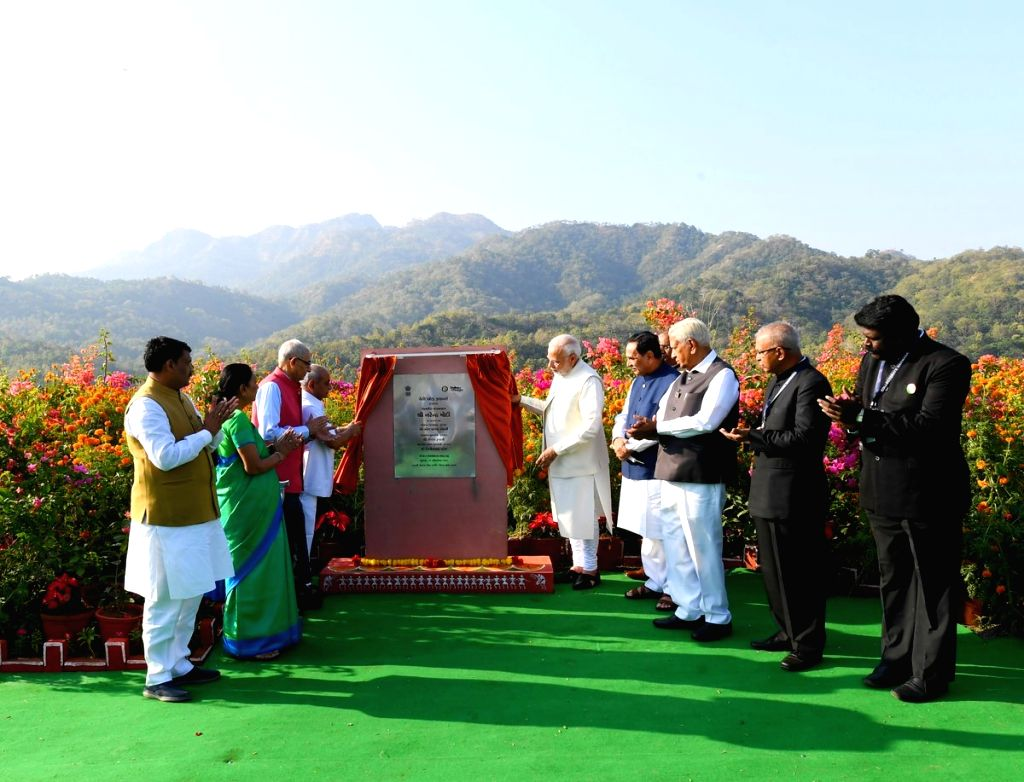 Prime Minister Narendra Modi unveils the plaque to inaugurate 'Valley of Flowers' in Kevadiya of Gujarat's Narmada District on Oct 31, 2018. Also seen Gujarat Governor Om Prakash Kohli, ... - Narendra Modi, Prakash Kohli, Nitin Patel and Anandiben Patel
