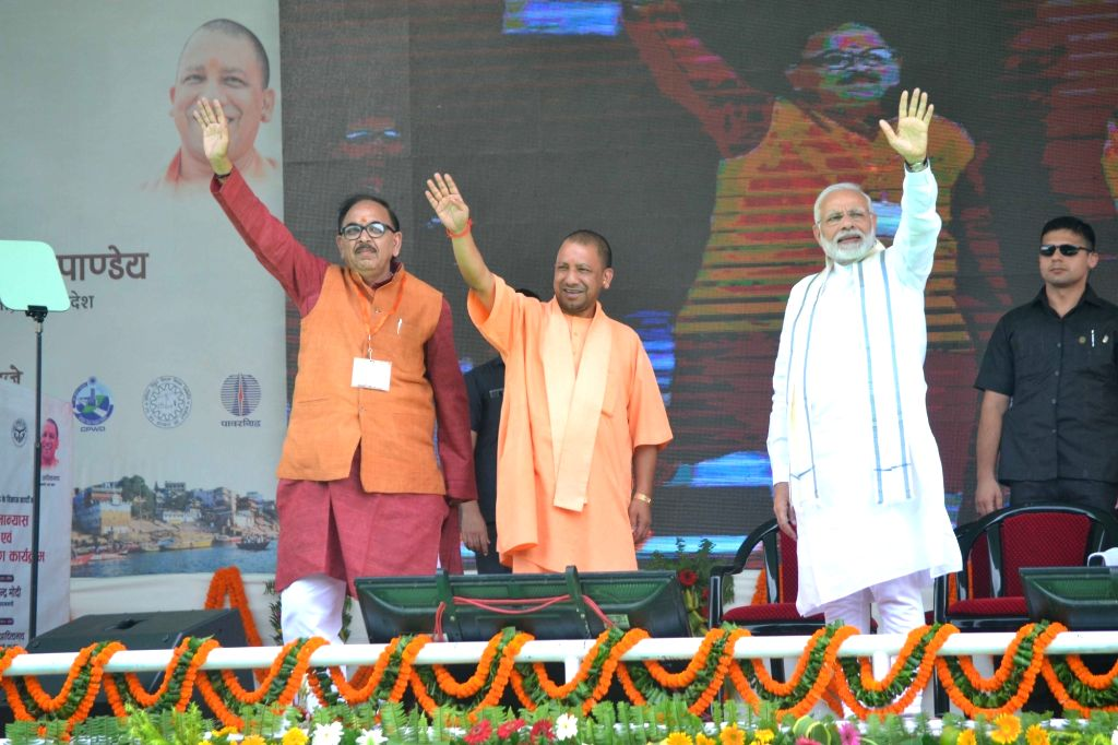 Prime Minister Narendra Modi, Uttar Pradesh Chief Minister Yogi Adityanath and UP BJP chief Mahendra Nath Pandey during the foundation stone laying ceremony of various development projects, ... - Narendra Modi and Mahendra Nath Pandey