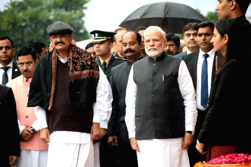 Prime Minister Narendra Modi, Vice President M. Venkaiah Naidu and Union Minister Pralhad Joshi pay tributes to the martyrs on 18th anniversary of Parliament attack at Parliament House in ... - Narendra Modi, M. Venkaiah Naidu and Pralhad Joshi