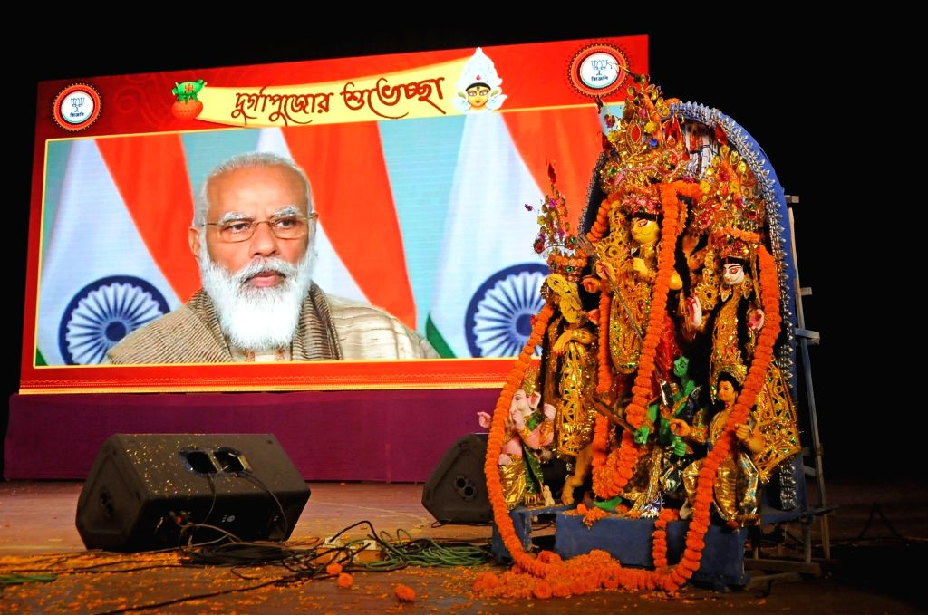 Prime Minister Narendra Modi virtually inaugurated Durga Puja celebrations jointly organised by the BJP Mohila Morcha and the party's Cultural cell at Salt Lake City in Kolkata on Oct 22, ... - Narendra Modi