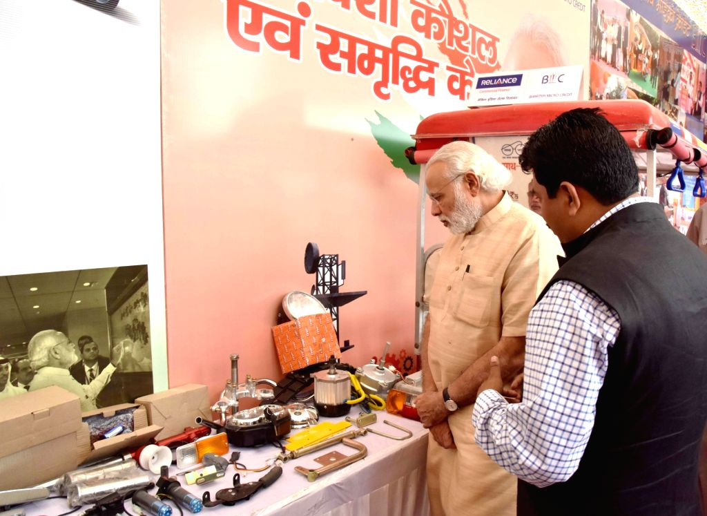 """Prime Minister Narendra Modi visits an exhibition during a programme organised to launch """"Stand Up India"""" in Noida, Uttar Pradesh on April 5, 2016. - Narendra Modi"""