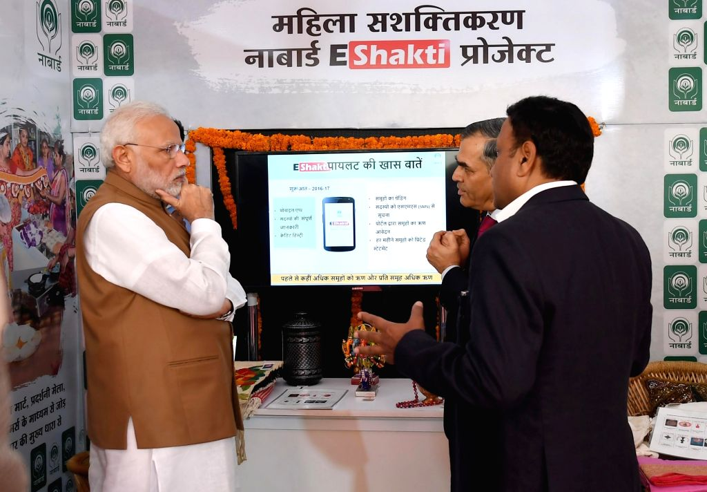 Prime Minister Narendra Modi visits an exhibition stall, at the launch of the Support and Outreach Initiative for MSMEs, in New Delhi on Nov 2, 2018. The  is also seen. - Narendra Modi