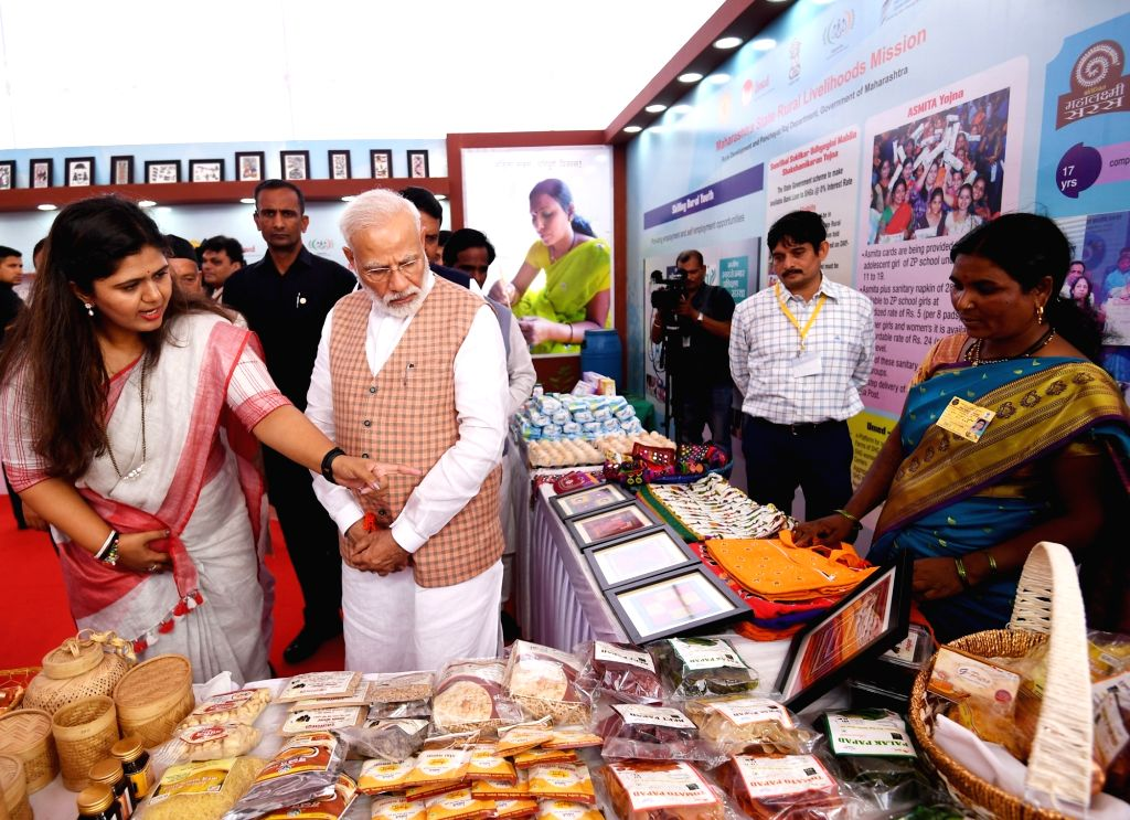 Prime Minister Narendra Modi visits an exhibition during a state-level 'Mahila Saksham Melava' or Empowered Women???s Meet of Self Help Groups (SHGs) organised by Maharashtra State Rural ... - Narendra Modi