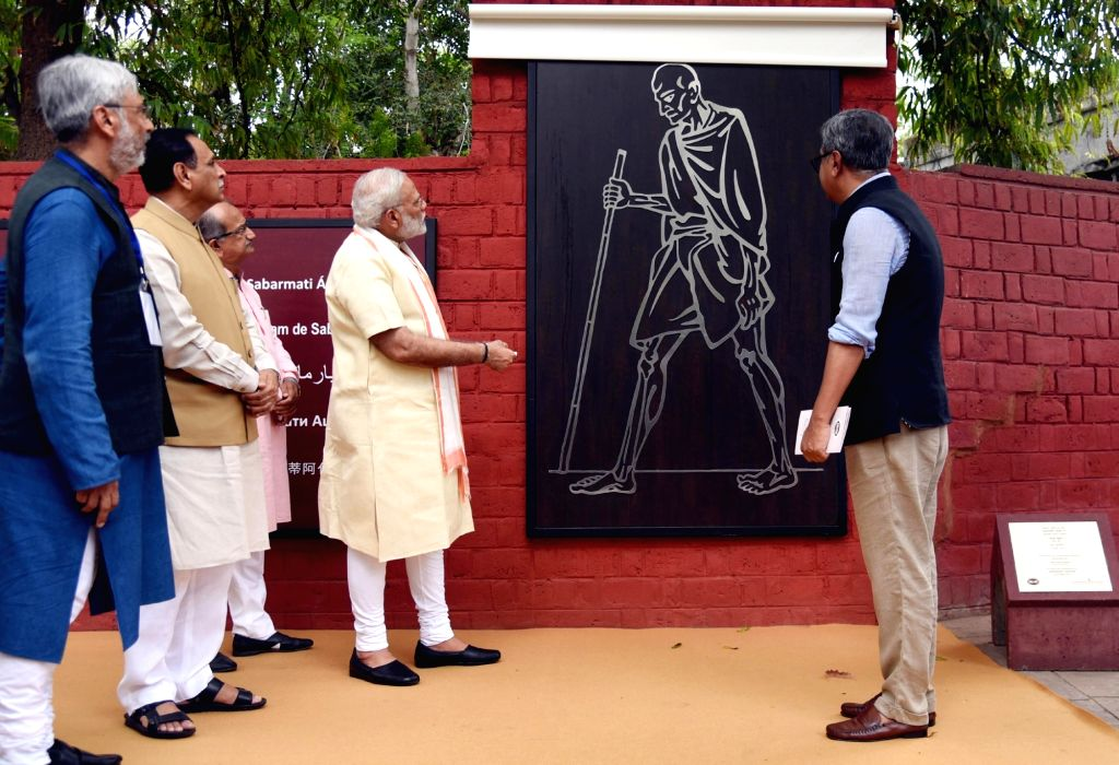 Prime Minister Narendra Modi visits Sabarmati Ashram in Ahmedabad, Gujarat on June 29, 2017.  Also seen Gujarat Chief Minister Vijay Rupani. - Narendra Modi