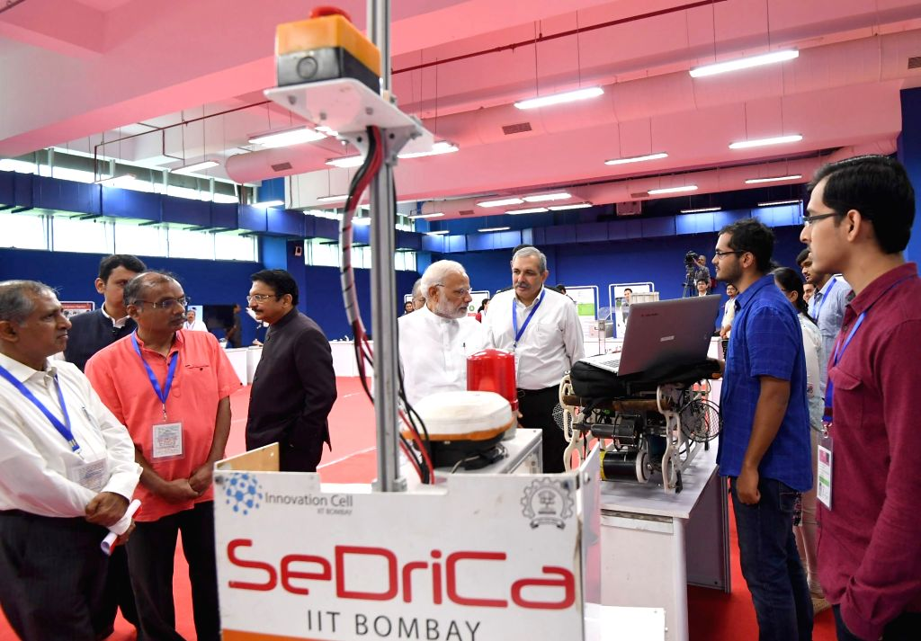 Prime Minister Narendra Modi visits the exhibition at the Indian Institute of Technology, Bombay, in Mumbai on Aug 11, 2018. Also seen Maharashtra Governor C. Vidyasagar Rao. - Narendra Modi and C. Vidyasagar Rao