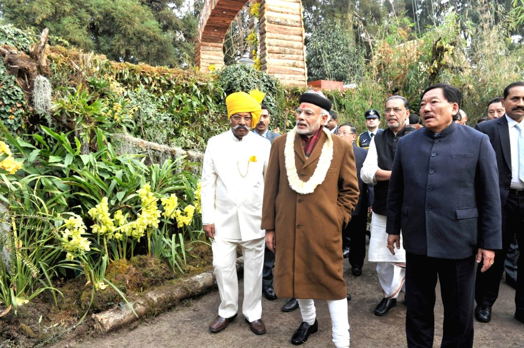 Prime Minister Narendra Modi visits the orchid display and seasonal flowers exhibition, in Gangtok on Jan 18, 2016. Also seen Sikkim Governor Shriniwas Dadasaheb Patil, Chief Minister ... - Narendra Modi, Shriniwas Dadasaheb Patil and Pawan Kumar Chamling
