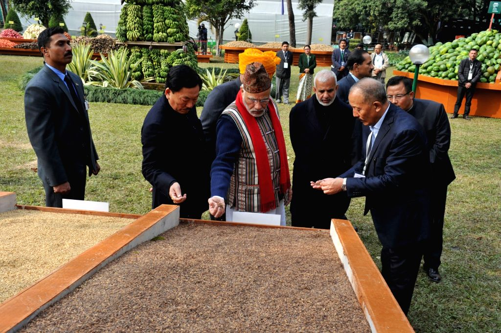 Prime Minister Narendra Modi visits the organic product exhibition, in Gangtok on Jan 19, 2016. Also seen Sikkim Chief Minister Pawan Kumar Chamling. - Narendra Modi and Pawan Kumar Chamling