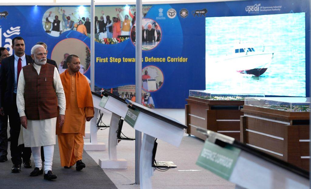 Prime Minister Narendra Modi visits the pavilions at the 11th edition of DefExpo2020 in Lucknow on Feb 5, 2020. Also seen Uttar Pradesh Chief Minister Yogi Adityanath. - Narendra Modi